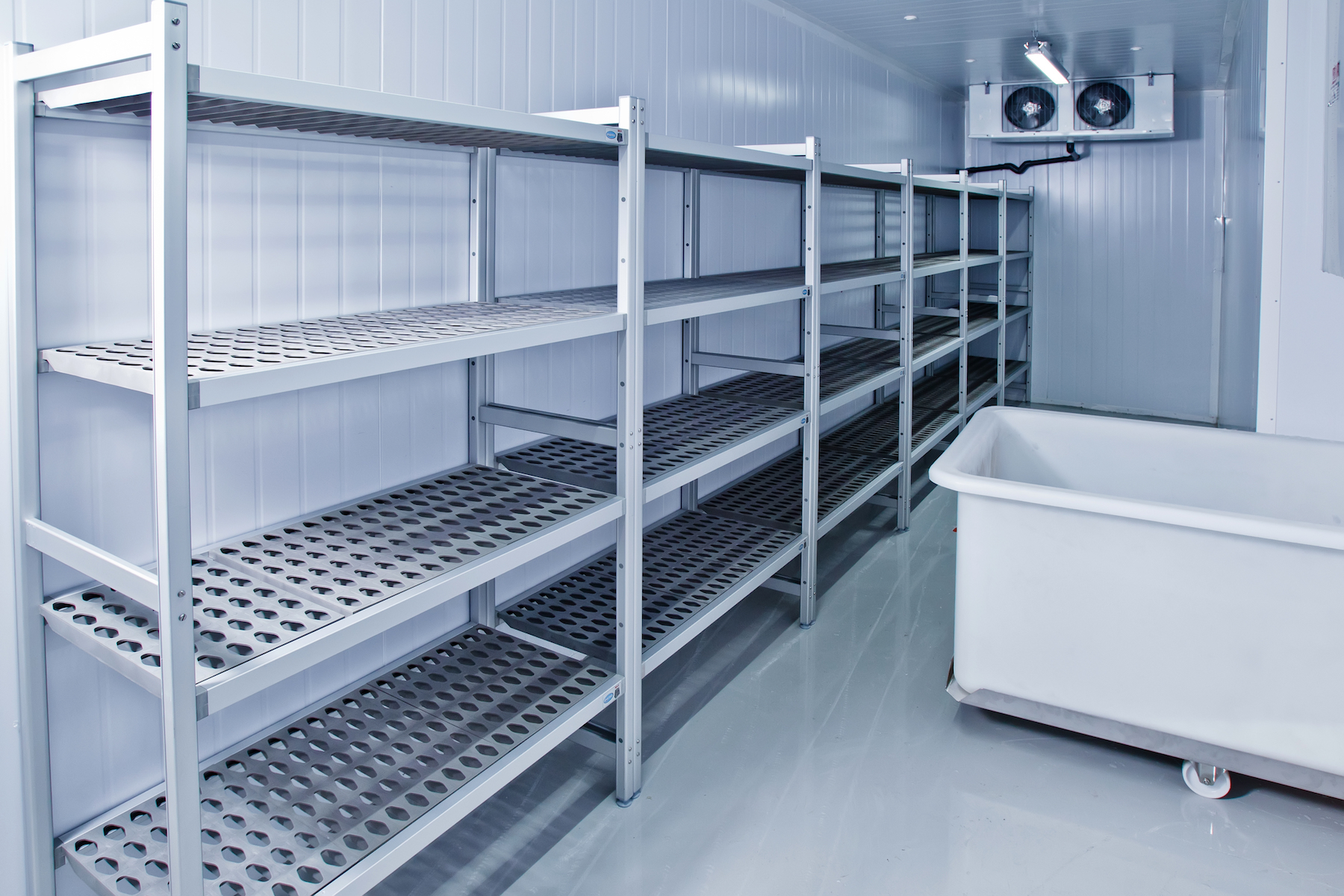 stock-photo-refrigerated-warehouse-room-for-creating-ice-and-food-storage-609094460